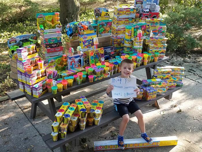 boy donates toys to hospital