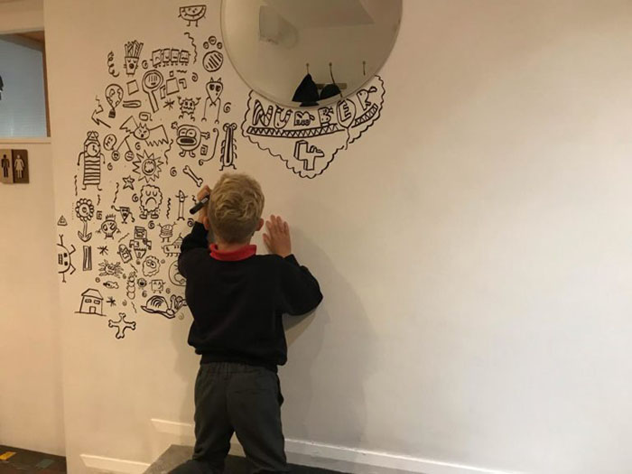 boy doodles for restaurant
