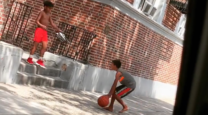 kid gives boy shoes to play basketball