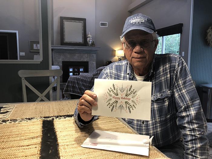 man pays community utility bills