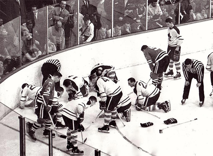 hockey players search for contact lens