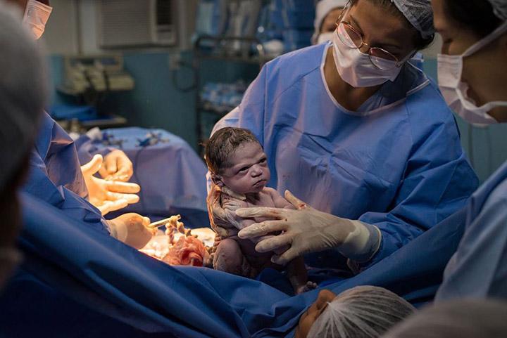 newborn baby unhappy face funny