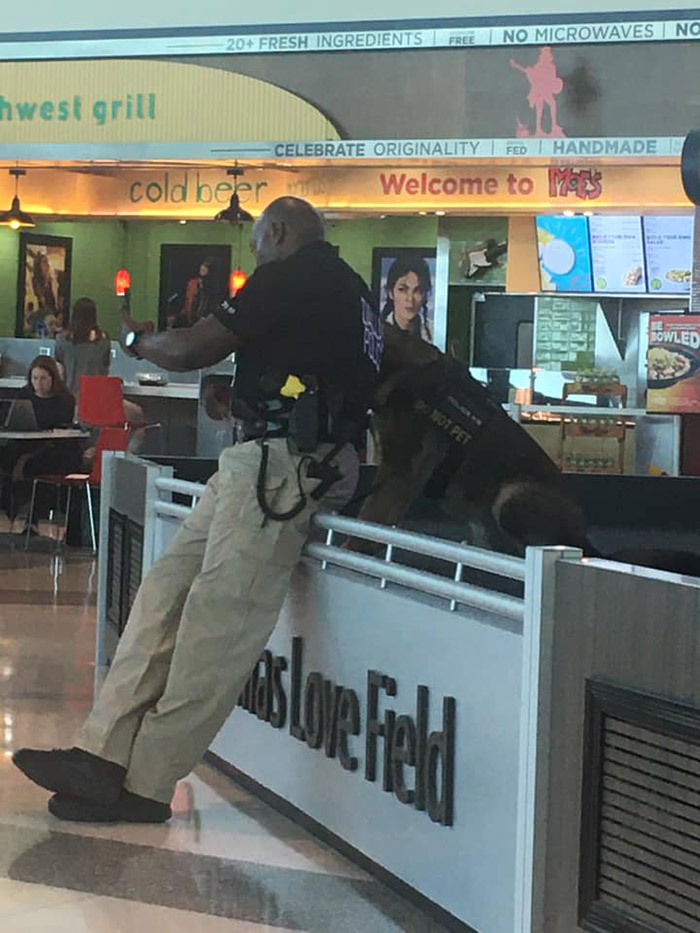 police officer selfies with dog and shows him airport dallas
