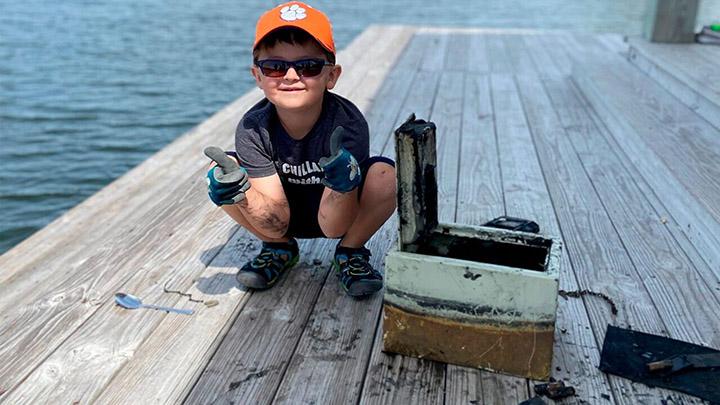 boy fishing finds stolen safe