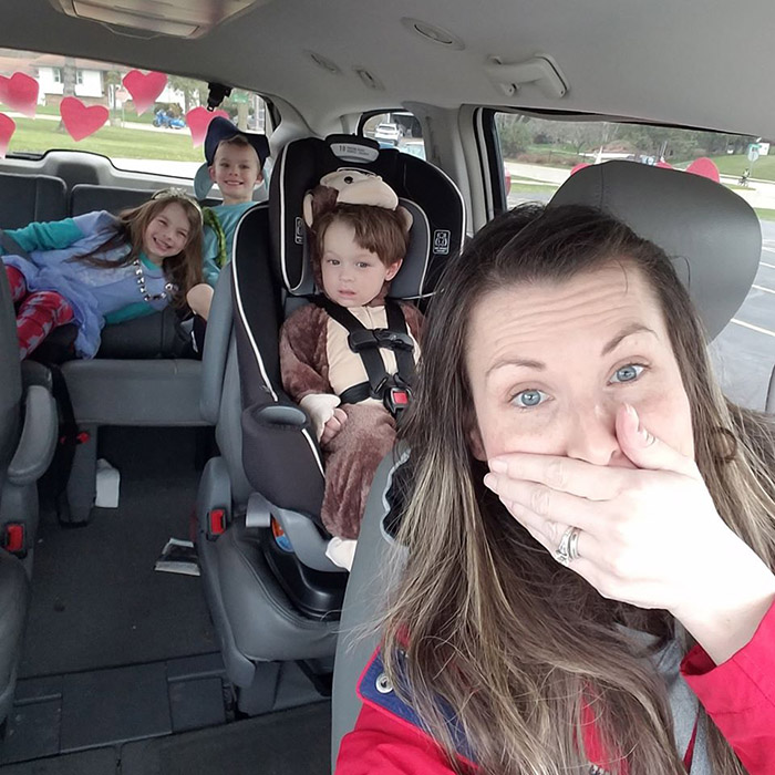 mom accidentally joins car parade in minivan