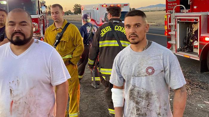 men rescue woman sinking car