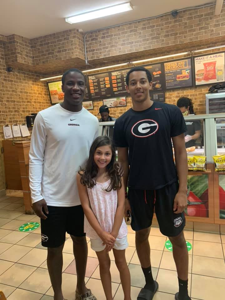 college football players help woman and child bathroom
