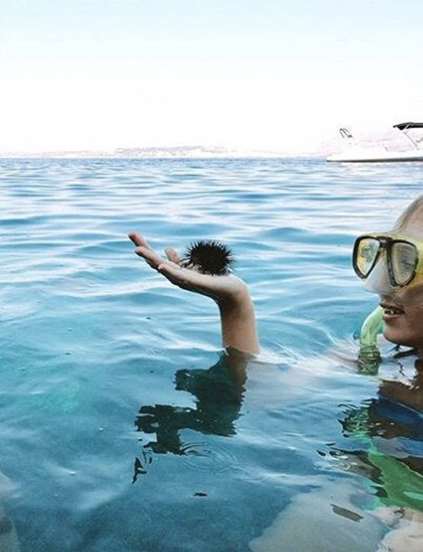 man diving in water confusing perspective