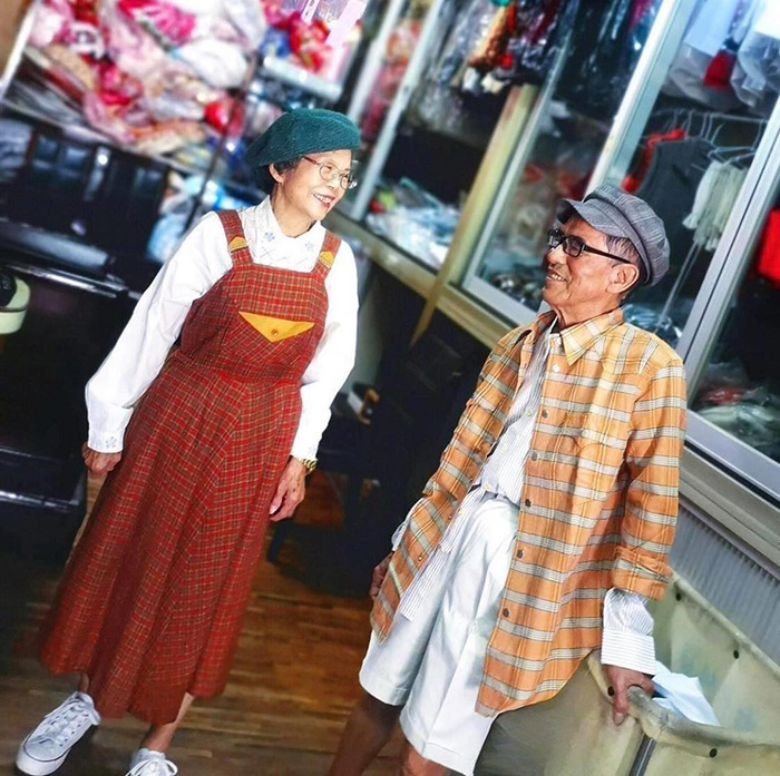 dry cleaning couple pose in clothes left behind