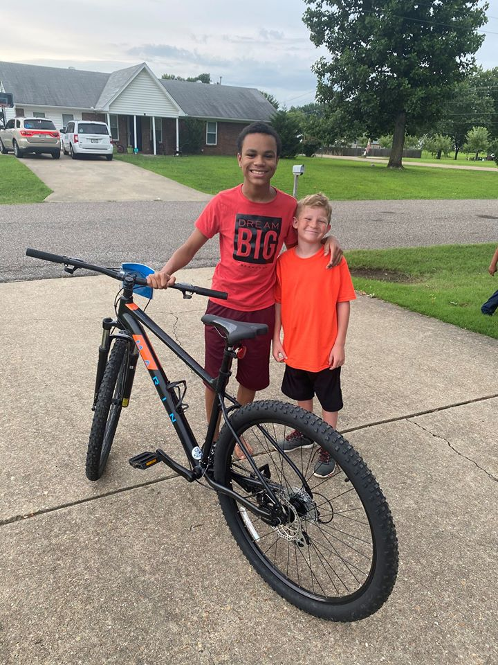 boy gives bike to neighbor