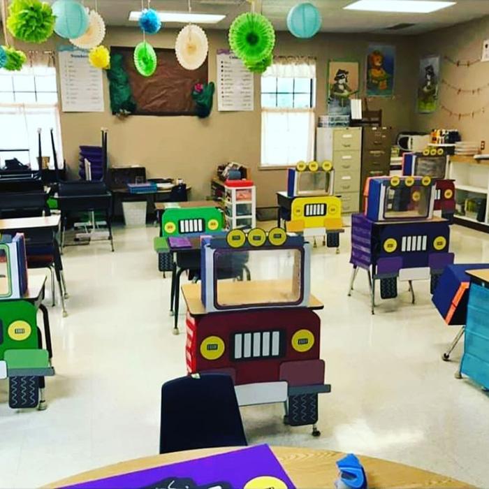 teacher creates social distancing desks for kids
