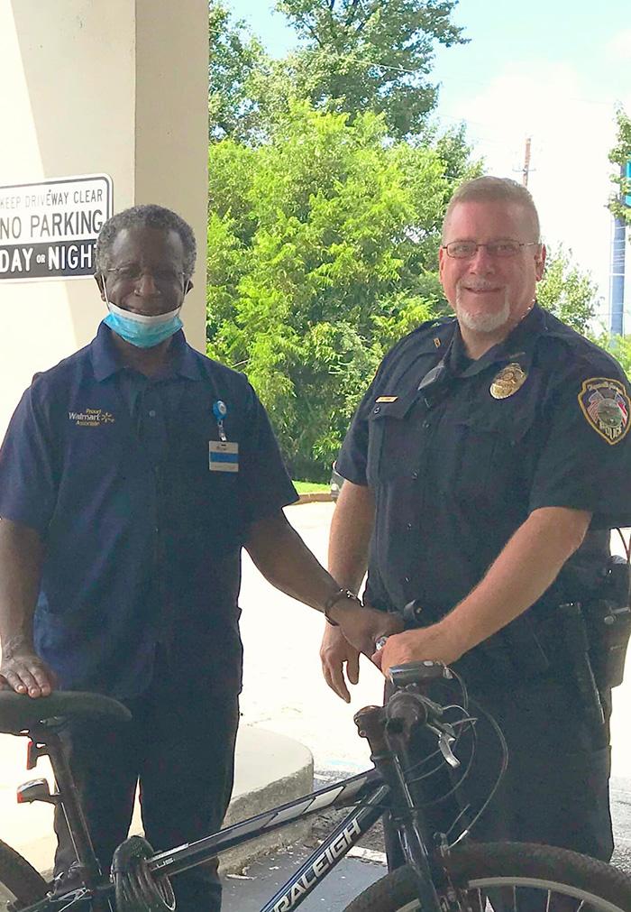 officer gives man bike
