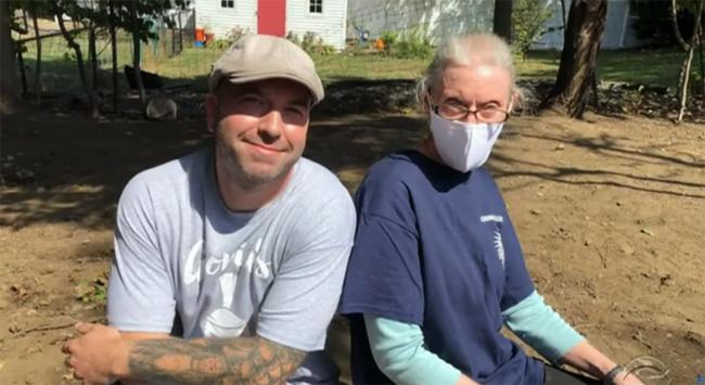 electrician helps fix elderly woman home