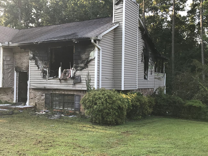 dog bark saves family from fire