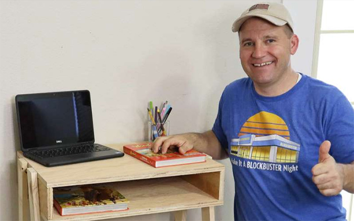dad builds desks for students in need