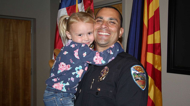 police officer adopts girl Brian Zach
