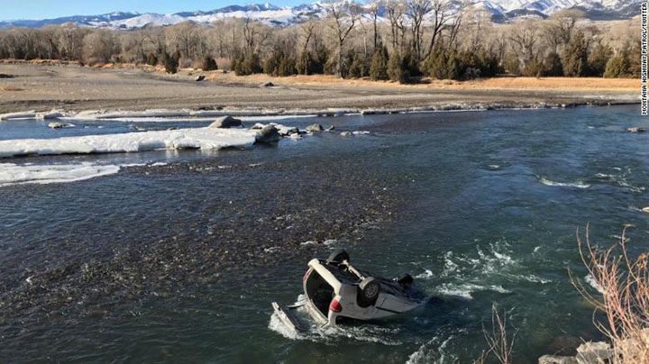 trooper rescues driver freezing river