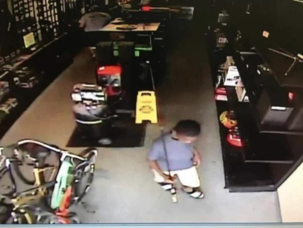 store owner gifts kid fishing rod