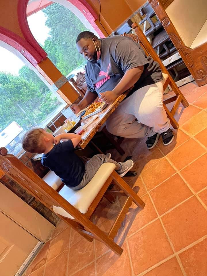 boy eats meal with stranger good news