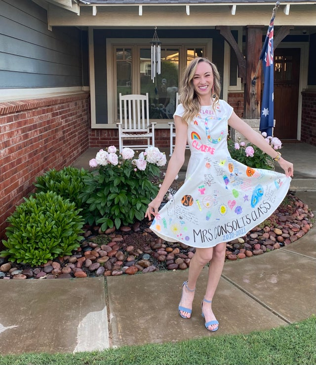 teacher wears dress decorated by students
