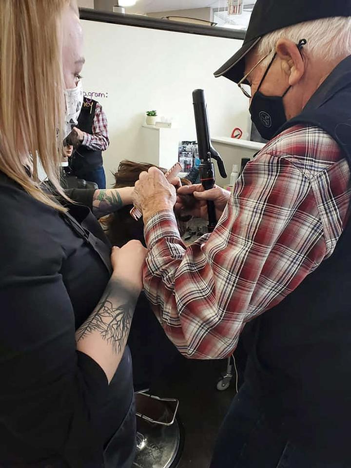 elderly man attends beauty school to help wife