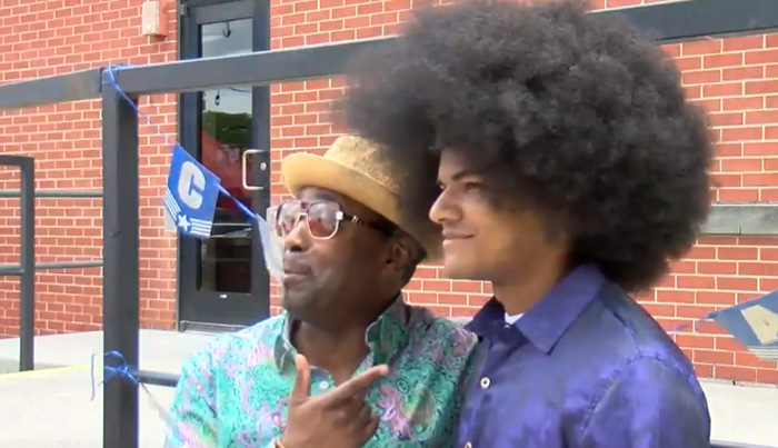 teen cuts afro for cancer