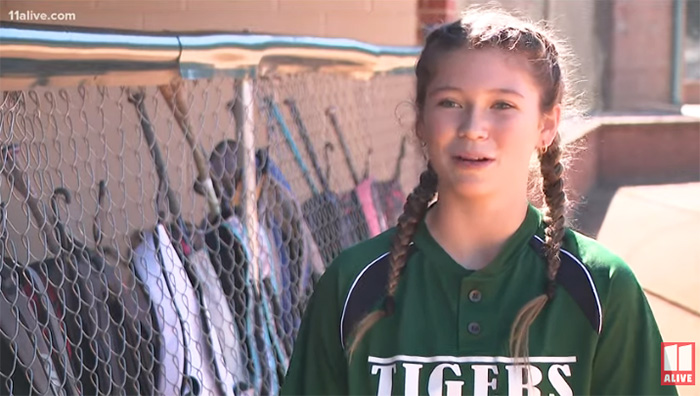 softball player helps opposing team